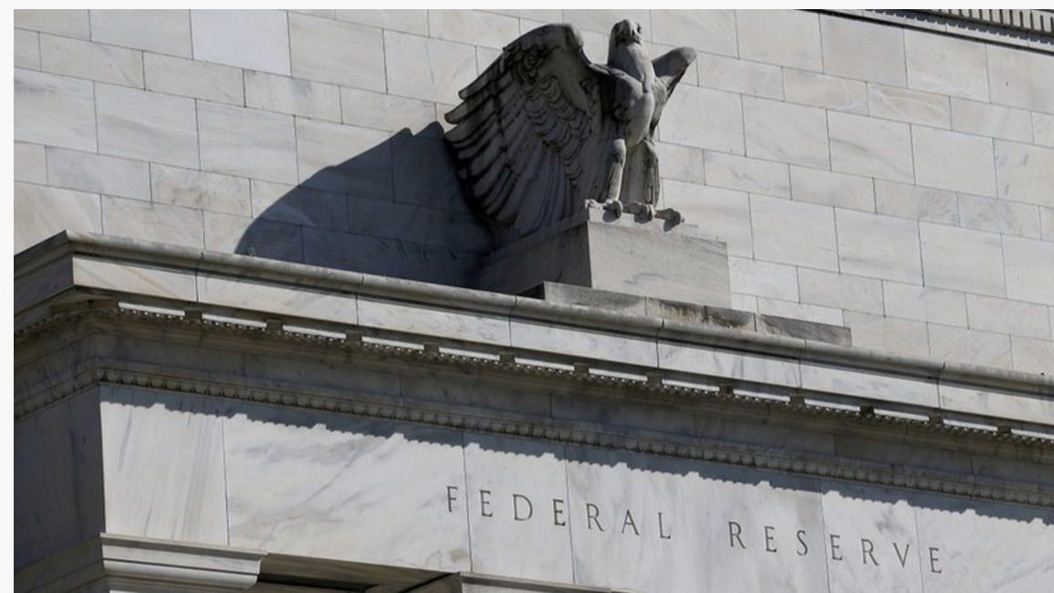 Fed cuts rates by quarter of a percentage point, gives mixed signals on next move