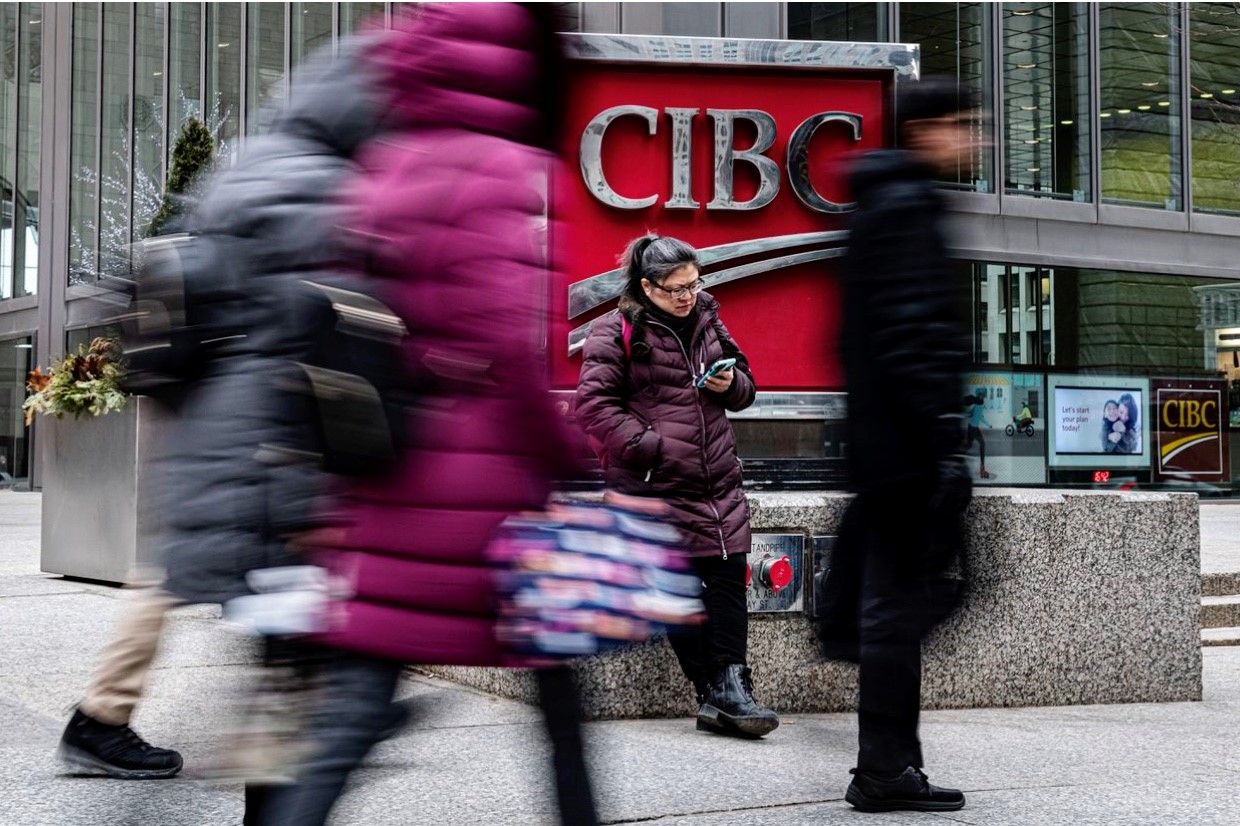 CIBC posts profit gain, hikes dividend as bank shuffles executive ranks, books restructuring charge